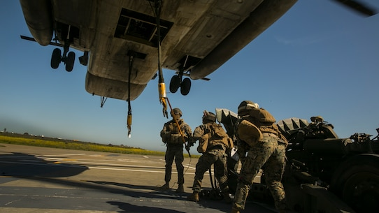 MARINE CORPS BASE CAMP PENDLETON, Calif. – Marines with Combat Logistics Battalion 15, 15th Marine Expeditionary Unit, lift a M777 Howitzer during PHIBRON-MEU integration training at Camp Pendleton, April 12, 2017. The CH-53E Super Stallion makes the MEU that much more capable as it is able to move personnel, equipment, and vehicles from ship to shore, demonstrating the 15th MEU's ship-to-shore connector capabilities. PMINT lays the foundation for all the elements of the MEU to develop relationships with their Navy counterparts and gain an understanding of the teamwork required to accomplish the mission. (U.S. Marine Corps photo by Cpl. Frank Cordoba)