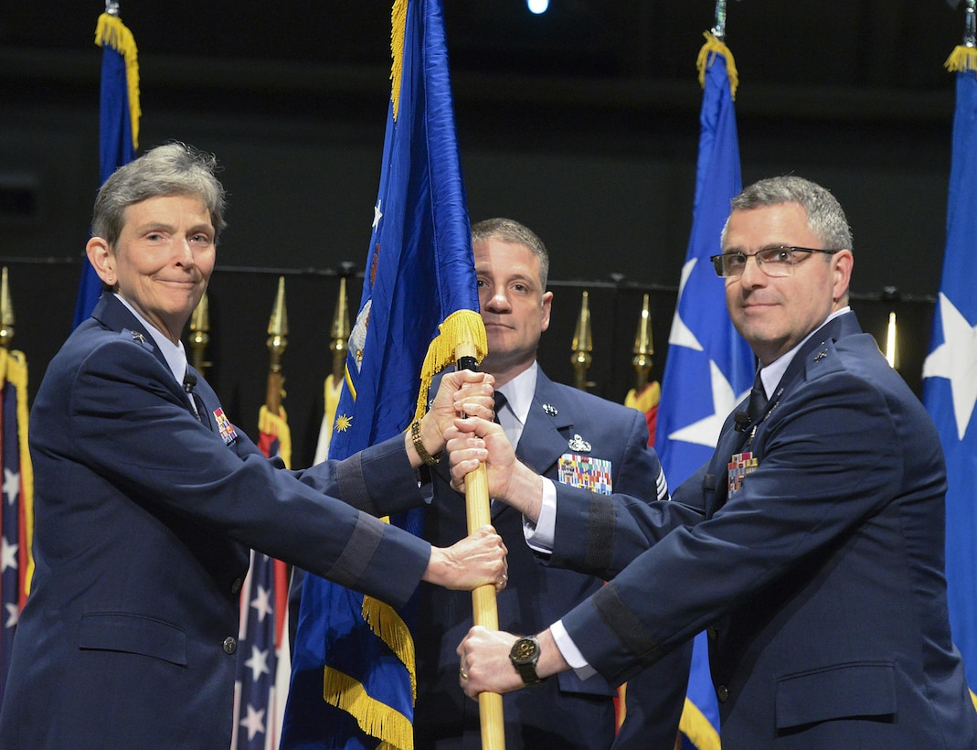 Brig. Gen. William T. Cooley assumes command of the Air Force Research Laboratory headquartered at Wright Patterson AFB, Ohio, from Gen. Ellen M. Pawlikowski, commander, Air Force Materiel Command, during a ceremony May 2 at the National Museum of the United States Air Force. (U.S. Air Force Photo/Richard Oriez)