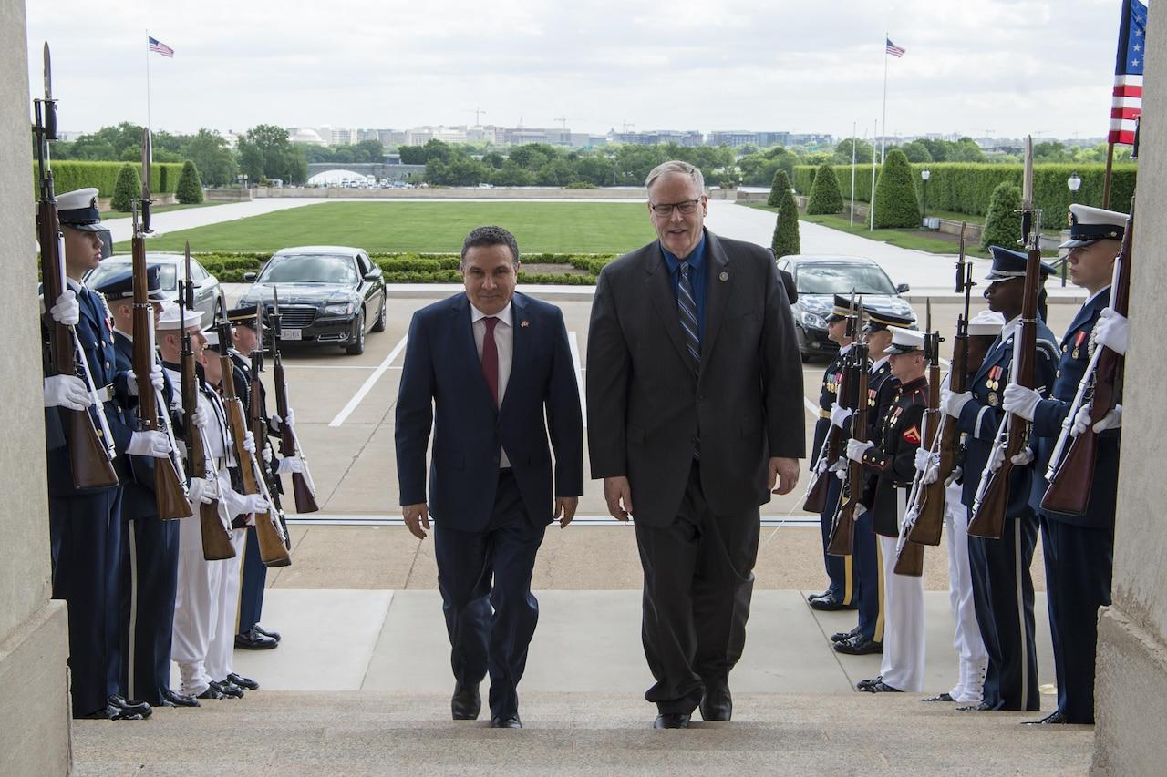 Deputy Defense Secretary Bob Work walks with Tunisian Defense Minister Farhat Horchani before a meeting at the Pentagon, May 2, 2017. DoD photo by Air Force Tech. Sgt. Brigitte N. Brantley