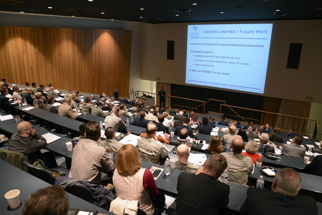 A cadet speaks to an audience of faculty members and industry partners at the FalconSAT End of Semester Review, April 28, 2017, at the U.S. Air Force Academy. (U.S. Air Force photo/Mike Kaplan)