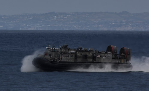 PACIFIC OCEAN, Calif., – A Landing Craft Air Cushion with Navy Assault Craft Unit 5 is piloted to the USS San Diego (LPD-22) in preparation to transport Marines and equipment with the 15th Marine Expeditionary Unit to conduct an amphibious assault during PHIBRON-MEU Integration, April 3, 2017. PMINT is the first at-sea training exercise and an opportunity for the Marines and Sailors to work as one team to complete essential missions.  This exercise lays the foundation for all the elements of the 15th MEU to develop relationships with their Navy counterparts and gain an understanding of the teamwork necessary to accomplish the mission with a focus on facilitating the integration of the blue-green team. (U.S. Marine Corps photo by Cpl. Timothy Valero)