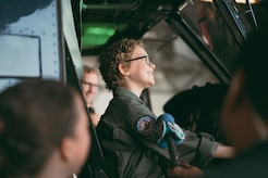 Carolyn Shaffer, Pilot for a Day participant, sits in a UH-1N Huey helicopter at Joint Base Andrews, Md., April 28, 2017. To honor and highlight Carolyn's battle against cancer, JBA teamed up with the Check-6 Foundation, a local non-profit, to make her Pilot for a Day. (U.S. Air Force photo by Senior Airman Delano Scott)