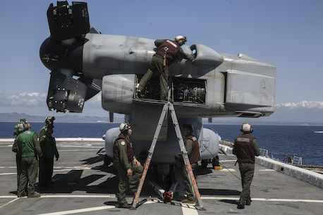 PACIFIC OCEAN, Calif., –  Marines with Marine Medium Tiltrotor Squadron 161 (Reinforced) conduct routine inspection and maintenance after a MV-22B Osprey landed on the flight deck of the USS San Diego (LPD-22) during PHIBRON-MEU Integration, April 8, 2017. PMINT is the first training period the 15th MEU and America Amphibious Ready Group team up to train for the upcoming deployment later this year. The amphibious force contains an extensive set of ship-to-shore connectors, by air or by sea, which allow the 15th MEU to move people or equipment to any corner of the world when called upon. (U.S. Marine Corps photo by Cpl. Timothy Valero)