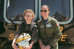 Carolyn Shaffer, left, Pilot for a Day participant, and 1st Lt. Katelyn Potts, 459th Air Refueling Wing KC-135 pilot, pose for a photo at Joint Base Andrews, Md., April 28, 2017. Guided by Potts and volunteers from numerous squadrons and organizations, Carolyn donned a personalized flight suit and flew a UH-1N Iroquois simulator, toured multiple aircraft including an F-16 Fighting Falcon and KC-135 Stratotanker, and participated in a variety of base demonstrations. (U.S. Air Force photo by Senior Airman Delano Scott)