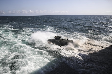 PACIFIC OCEAN, Calif., – An Assault Amphibious Vehicle with the 15th Marine Expeditionary Unit Battalion Landing Team drive off the edge of the USS SAN DIEGO's (LPD-22) well deck to conduct amphibious training during PHIBRON-MEU Integration, April 8, 2017. PMINT is the 15th MEU's first at-sea training exercise integrating with the Navy to accomplish mission critical tasks. The distinct ability of amphibious forces to gain access to critical areas anywhere in the world with ground, air, and logistics forces enables the Navy-Marine Corps team to shape actions across the range of military operations. (U.S. Marine Corps photo by Cpl. Timothy Valero)