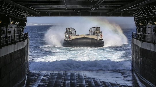 PACIFIC OCEAN, Calif., –  A Landing Craft, Air Cushion with Navy Assault Craft Unit 5 approaches the well deck of the USS San Diego (LPD-22) during PHIBRON-MEU Integration, April 8, 2017. PMINT is the first at-sea training exercise and an opportunity for the Marines and Sailors to work as one team to complete essential missions.  This exercise lays the foundation for all the elements of the 15th MEU to develop relationships with their Navy counterparts and gain an understanding of the teamwork necessary to accomplish the mission with a focus on facilitating the integration of the blue-green team. (U.S. Marine Corps photo by Cpl. Timothy Valero)