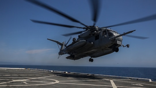 PACIFIC OCEAN, Calif., – A CH-53E Super Stallion lifts off from the flight deck on the USS San Diego (LPD-22) to transport Marines and equipment to the USS America (LHA-6), April 10, 2017. The 15th MEU uses the air assets provided by Marine Medium Tiltrotor Squadron 161 (Reinforced) to transport personnel and equipment ship-to-ship and ship-to-shore efficiently. The 15th MEU's rapid ability to mobilize people and equipment makes the amphibious force uniquely postured to respond to any mission around the globe. (U.S. Marine Corps photo by Cpl. Timothy Valero)