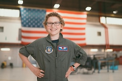 Carolyn Shaffer, Pilot for a Day participant, poses in a hangar at Joint Base Andrews, Md., April 28, 2017. To honor and highlight Shaffer's battle against cancer, JBA teamed up with the Check-6 Foundation, a local non-profit, to make her Pilot for a Day. (U.S. Air Force photo by Senior Airman Delano Scott)