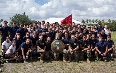 U.S. Marines and Future Marines with Recruiting Substation South Dade pose for a group photo after placing first in the Recruiting Station (RS) Fort Lauderdale Annual Pool Function at Marine Corps Reserve Station Hialeah, Hialeah, Florida, Apr. 29, 2017. The annual pool function brought together every recruiting substation within RS Fort Lauderdale for a day of field meet events, friendly competition, and time with Marine Corps drill instructors. The annual function promotes camaraderie while providing Future Marines a sense of what it feels like to be a Marine recruit in the presence of drill instructors. (U.S. Marine Corps photo by Lance Cpl. Jack A. E. Rigsby/Released)