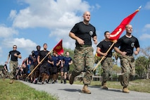 U.S. Marines and Future Marines participate in a formation run during the Recruiting Station (RS) Fort Lauderdale Annual Pool Function at Marine Corps Reserve Station Hialeah, Hialeah, Florida, Apr. 29, 2017. The annual pool function brought together every recruiting substation within RS Fort Lauderdale for a day of field meet events, friendly competition, and time with Marine Corps drill instructors. The annual function promotes camaraderie while providing Future Marines a sense of what it feels like to be a Marine recruit in the presence of drill instructors. (U.S. Marine Corps photo by Lance Cpl. Jack A. E. Rigsby/Released)