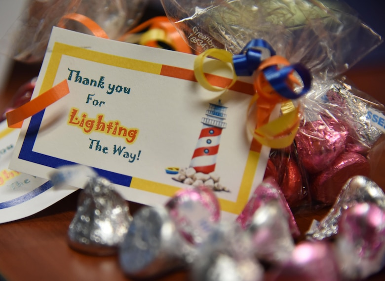 A tag and candy sit on display during the Annual Volunteer Recognition Ceremony in the Sablich Center April 27, 2017, on Keesler Air Force Base, Miss. The event recognized Keesler personnel, family member and retiree volunteers for their volunteer service in 2016. (U.S. Air Force photo by Kemberly Groue)