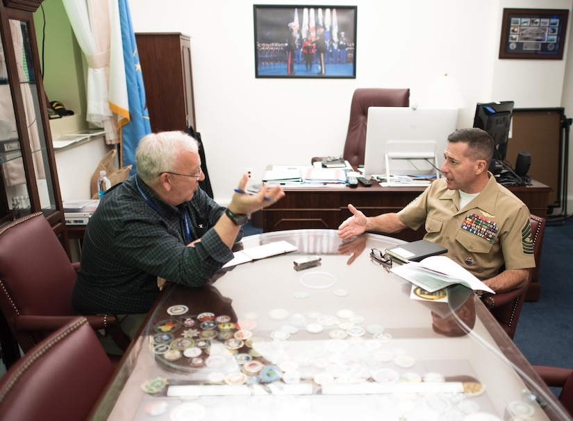 Jim Garamone, DoD News journalist, speaks with Marine Corps Sgt. Maj. Anthony A. Spadaro, senior enlisted leader for U.S. Pacific Command, about the importance of partnerships in Pacom's area of responsibility. DoD photo by Army Sgt. James K. McCann