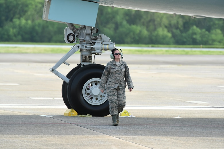 Staff Sgt. Katelyn Zimmerman, 193rd Special Operations Wing instruments and flight controls system specialist, walks away from Air Force One after chalking the front wheels once it landed at the 193rd SOW, Middletown, Pennsylvania, April 29, 2017. President Donald J. Trump and Vice President Mike Pence; whom landed earlier, were on their way to the Harrisburg Farm Show Complex for President Trump's 100th day rally. (U.S. Air National Guard Photo by Master Sgt. Culeen Shaffer/Released)