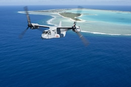 An MV-22B Osprey, assigned to Marine Medium Tiltrotor Squadron (VMM) 163 (Reinforced), embarked aboard the amphibious assault ship USS Makin Island (LHD 8), flies past Wake Island, April 24, 2017. Makin Island, the flagship for the Makin Island Amphibious Ready Group, with the embarked 11th Marine Expeditionary Unit, is operating in the Pacific Ocean to enhance amphibious capability with regional partners and to serve as a ready-response force for any type of contingency.