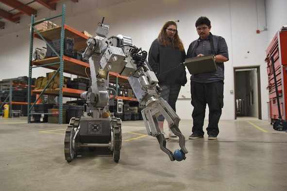 Paideia High School students operate a robot during a Science, Technology, Engineering and Math tour hosted by the 92nd Civil Engineer Squadron May 1, 2017, at Fairchild Air Force Base, Washington. The students were exposed to numerous forms of engineering including civil, geotechnical, structural, environmental and mechanical. (U.S. Air Force photo/Senior Airman Mackenzie Richardson)