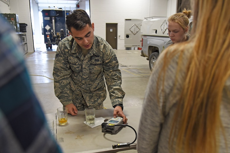 Senior Airman Garrett Olson, 92nd Civil Engineer Squadron explosive ordinance disposal journeyman, uses a mass spectrometer to identify and quantify molecules in simple mixtures such as baking soda, acetone and gasoline during a Science, Technology, Engineering and Math tour hosted by the 92nd CES May 1, 2017, at Fairchild Air Force Base, Washington. The students received numerous hands-on demonstrations including night vision goggles and robotics. (U.S. Air Force photo/Senior Airman Mackenzie Richardson)