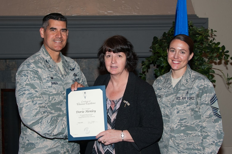Col. Eric Shafa, 42nd Air Base Wing commander, presents Dorie Henley with the Volunteer Excellence Award on Maxwell Air Force Base, Ala., April 27, 2017.  All of the 2016 volunteers were recognized for their service and awarded certificates. (US Air Force photo by Bud Hancock)