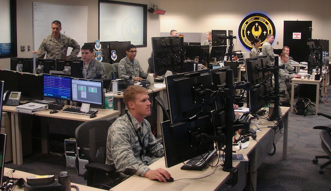 1st Space Operations Squadron Geosynchronous Space Situational Awareness and Space Based Space Surveillance crews operate satellite vehicles in the new, combined ops floor at Schriever Air Force Base, Colorado Friday, April 28, 2017. This marked the first time space situational awareness operations were brought together into one ops floor, named Mod 9. (Courtesy photo)