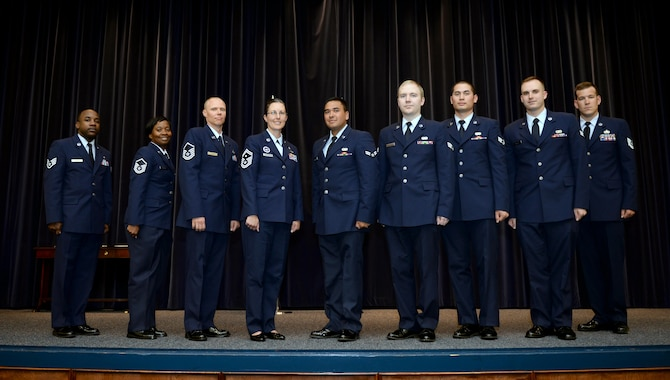 Airmen from Maxwell Air Force Base, Ala., pose for a photo during the monthly promotion ceremony, April 28, 2017. (U.S. Air Force photo/Senior Airman Tammie Ramsouer)