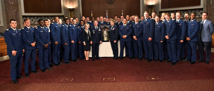 Air Force Chief of Staff Gen. David L. Goldfein, his wife Dawn and Air Force Academy Superintendent Lt. Gen. Michelle Johnson pose for a photo during the Congressional social congratulating the U.S. Air Force Academy football team for winning the Commander in Chief's Trophy, at the Dirkson Senate Office Building in Washington, D.C., May 1, 2017. (U.S. Air Force photo/Wayne A. Clark)