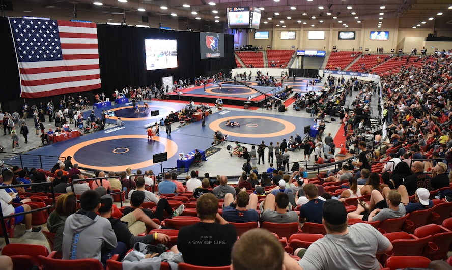 Fans watch multiple wrestling matches at the 2017 Open Wrestling Championships in Las Vegas, Nev., April 29, 2017. Those who qualify during this tournament will go on to compete for the United States against other countries. (U.S. Air Force photo by Airman 1st Class Breanna Carter)