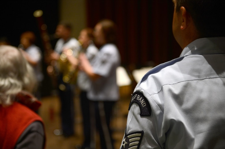 Tech. Sgt. Andrew Tucker, U.S. Air Force Band of the Golden West percussion player, stands at attention during the national anthem, performed by the Golden West Winds, May 1, 2017 in Seattle, Wash. While on tour in Washington, the Golden West Winds performed at Kent United Methodist Church and the Seattle Public Library. (U.S. Air Force photo/Senior Airman Divine Cox)