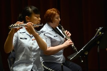 Master Sgt. Coreen Levin (center), Golden West Winds NCO in charge and oboe player, and Airman 1st Class Candy Chang (left), Golden West Winds flute player, perform for members of the Seattle community while on tour May 1, 2017 in Seattle, Wash. Levin and Chang are both from the Pacific Northwest Region. (U.S. Air Force photo/Senior Airman Divine Cox)
