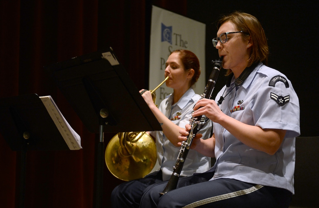Airman 1st Class Hilary Zirkle (left), Golden West Winds clarinet player, and Airman 1st Class Emily Hoffner (center), french horn player, perform for members of the Seattle community while on tour May 1, 2017 in Seattle, Wash. Comprised of the flute, oboe, clarinet, french horn, and bassoon, this ensemble supports a wide variety of musical events which include public concerts, military ceremonies, patriotic shows, and educational programs. (U.S. Air Force photo/Senior Airman Divine Cox)