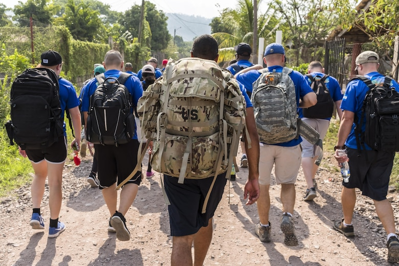 More than 190 members of Joint Task Force-Bravo hiked approximately 3.6 miles round-trip to the village of San Jerónimo, Comayagua, Honduras, Apr. 29, 2017. Members carried more than 5025 lbs of food and supplies, 24 soccer balls and 3 piñatas to the people of San Jerónimo. Chapel hikes have been occurring since 2003, with the JTF-Bravo Chapel sponsoring an average of six every year. The hikes are designed to provide a practical way for JTF-Bravo members to engage and partner with local communities to provide support to surrounding villages in need of food and supplies. (U.S. Air National Guard photo by Master Sgt. Scott Thompson/released)