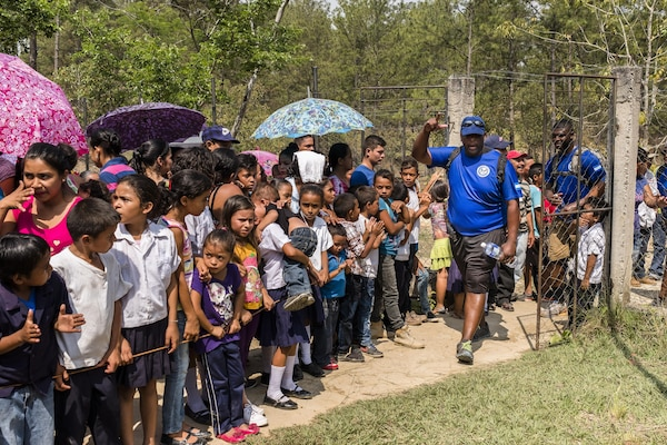 Villagers of San Jerónimo, Comayagua, Honduras wait for more than 190 members of Joint Task Force-Bravo to hiked approximately 3.6 miles round-trip to the village, Apr. 29, 2017. Members carried more than 5025 lbs of food and supplies, 24 soccer balls and 3 piñatas to the people of San Jerónimo. Chapel hikes have been occurring since 2003, with the JTF-Bravo Chapel sponsoring an average of six every year. The hikes are designed to provide a practical way for JTF-Bravo members to engage and partner with local communities to provide support to surrounding villages in need of food and supplies. (U.S. Air National Guard photo by Master Sgt. Scott Thompson/released)