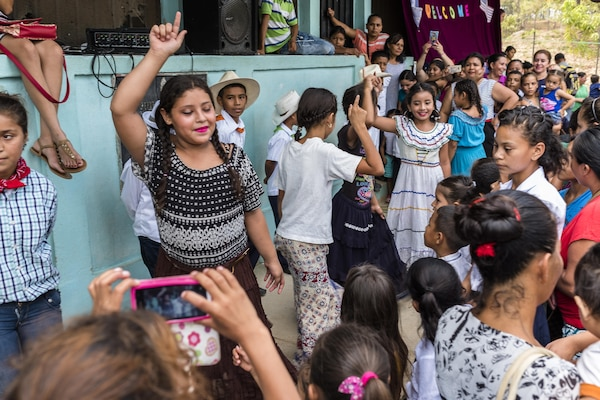 School children from San Jerónimo, Comayagua, Honduras show traditional Honduran dances to more than 190 members of Joint Task Force-Bravo who hiked approximately 3.6 miles round-trip to the village, Apr. 29, 2017. Members carried more than 5025 lbs of food and supplies, 24 soccer balls and 3 piñatas to the people of San Jerónimo. Chapel hikes have been occurring since 2003, with the JTF-Bravo Chapel sponsoring an average of six every year. The hikes are designed to provide a practical way for JTF-Bravo members to engage and partner with local communities to provide support to surrounding villages in need of food and supplies. (U.S. Air National Guard photo by Master Sgt. Scott Thompson/released)