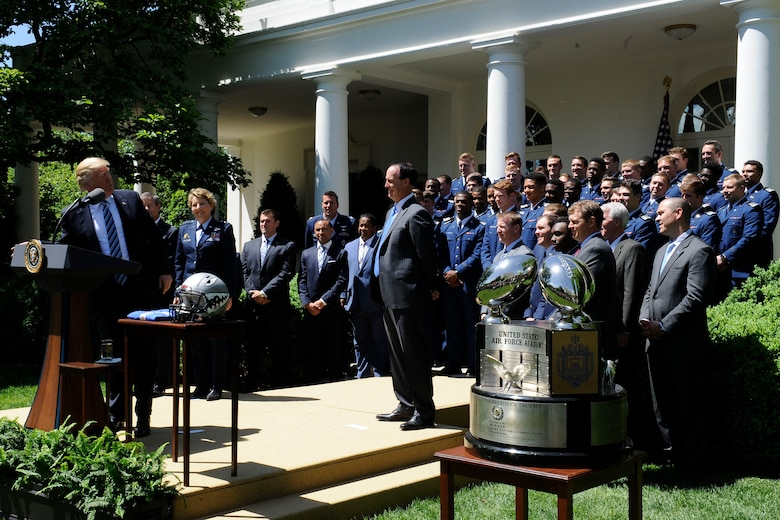 President Donald Trump congratulates the U.S. Air Force Academy football team with the Commander in Chief's Trophy at the White House May 2, 2017. With the team were Lt. Gen. Michelle D. Johnson, the U.S. Air Force Academy superintendent; Acting Secretary of the Air Force Lisa S. Disbrow; and Air Force Chief of Staff Gen. David L. Goldfein. (U.S. Air Force photo/Staff Sgt. Jannelle McRae)