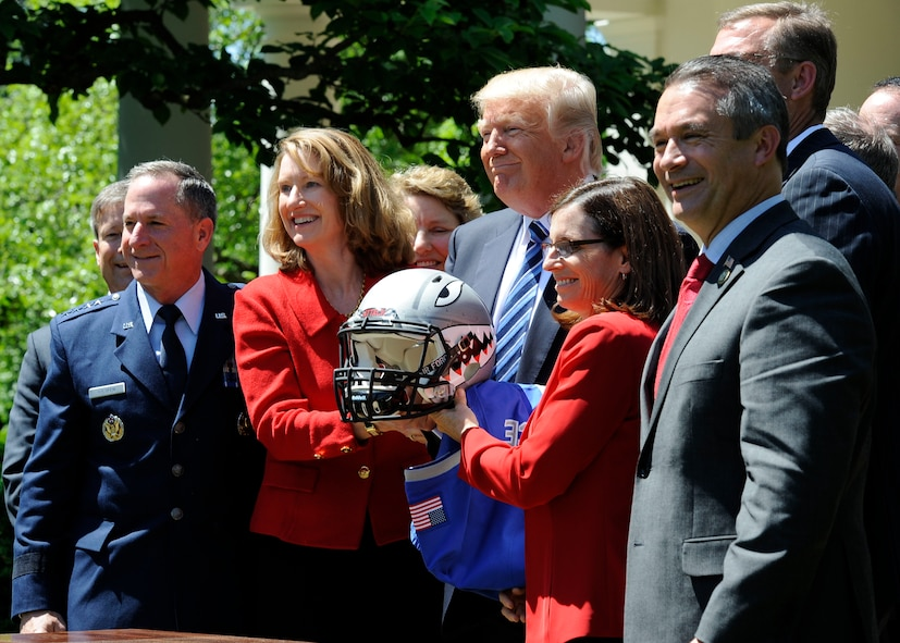 Air Force Chief of Staff Gen. David L. Goldfein, (left), and Acting Secretary of the Air Force Lisa S. Disbrow pose for a photo with President Donald Trump at the White House, May 2, 2017. Trump congratulated the U.S. Air Force Academy football team with the Commander -in -Chief's Trophy. (U.S. Air Force photo/Staff Sgt. Jannelle McRae)