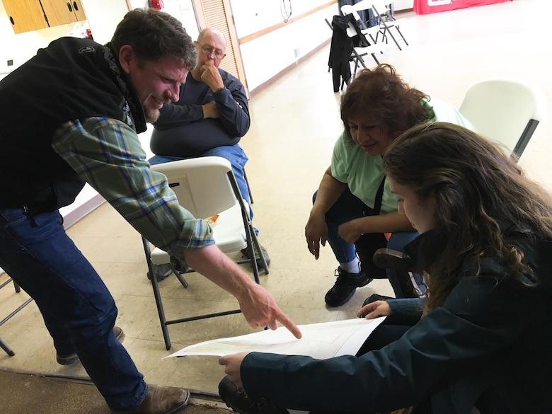 Sacramento District Water Resources Planners Hunter Merritt, far right, and Patricia Fontanet, second from right, meet with members of the Skull Valley Reservation community during an outreach event held on the reservation in April.