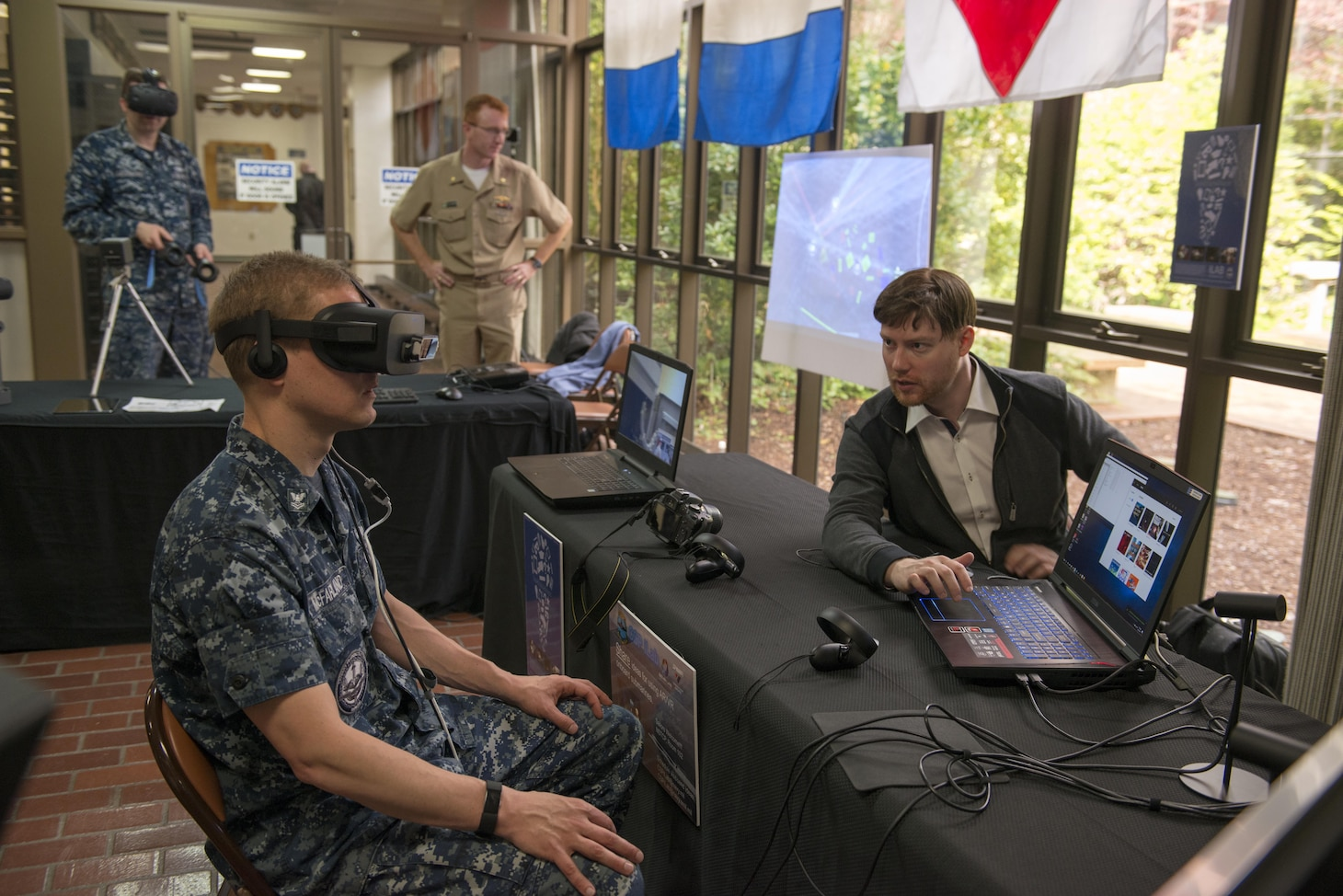 BANGOR, Wash. (April 27, 2017) Sonar Technician 2nd Class Andrew McFarland, assigned to Trident Training Facility (TTF) Bangor, tests the OceanLens, which uses an Oculus Rift virtual reality headset to create a 3D immersive environment for visualizing undersea topography, during the Innovation Lab (iLab) roadshow held at Trident Training Facility Bangor. The iLab, which is located at Naval Submarine Training Center Pacific, in Pearl Harbor, Hawaii, is an initiative launched to spur the rapid development of ideas and concepts to actionable use in submarine warfare. (U.S. Navy photo by Mass Communication Specialist 1st Class Amanda R. Gray/Released)