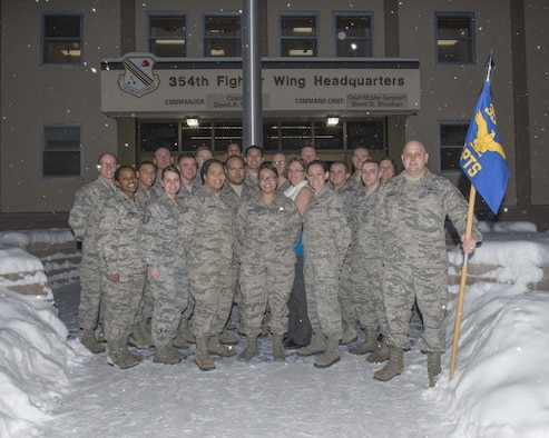 Members of the 354th Comptroller Squadron (CPTS) pose for a group photo, Dec. 21, 2016, at Eielson Air Force Base, Alaska. The 354th CPTS ensures travel vouchers are completed by hand,which reduced errors made by customers who used to complete their voucher on their own. (U.S. Air Force photo by Staff Sgt. Ashley Nicole Taylor)