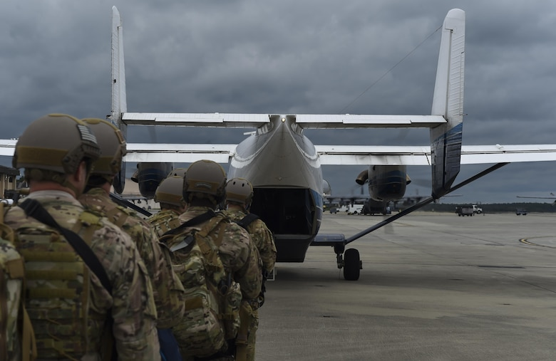 Combat aviation advisor students with the 6th Special Operations Squadron load onto a C-145A Skytruck during Operation Raven Claw at Hurlburt Field, Fla., April 24, 2017. Raven Claw is the capstone event for the Air Force Special Operations Training Center's combat aviation advisor mission qualification course. (U.S. Air Force photo by Airman 1st Class Joseph Pick)