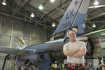 "EIELSON AIR FORCE BASE, Alaska – U.S. Air Force Senior Airman Michael ""Tater"" Brinkmeyer, a 354th Aircraft Maintenance Squadron crew chief, poses for a photo in front of an F-16 Fighting Falcon from the 18th Aggressor Squadron during NORTHERN EDGE 2017 (NE17), May 2, 2017, at Eielson Air Force Base, Alaska. NE17 is Alaska's premier joint training exercise designed to practice operations, techniques and procedures as well as enhance interoperability among the services. Thousands of participants from all the services, Airmen, Soldiers, Sailors, Marines and Coast Guardsmen from active duty, Reserve and National Guard units are involved. (U.S. Air Force photo/Staff Sgt. Ashley Nicole Taylor)"