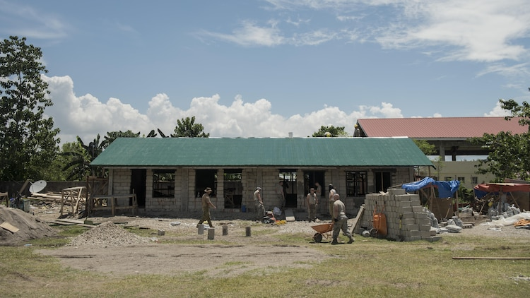 U.S. military, Australian Army, and Armed Forces of the Philippines service members prepare to pour concrete during construction of a community building during Balikatan 2017 in Ormoc City, Leyte, April 29, 2017. Engineers from the three nations worked together to build new classrooms at Margen Elementary School in Ormoc City. Balikatan is an annual U.S.-Philippine military bilateral exercise focused on a variety of missions, including humanitarian assistance and disaster relief, counterterrorism, and other combined military operations.