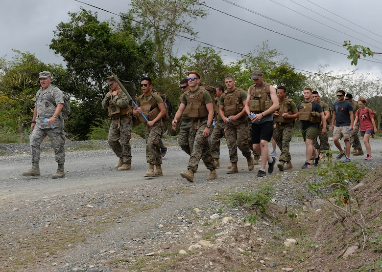 U.S. Air Force Col. Michael Weymeyer, the 346th Air Expeditionary Group commander, leads a group of U.S. service members on a march uphill while participating in the Sexual Assault Prevention and Response 5K Ruck March in Arroyo Cano, Dominican Republic, April 9, 2017. Both men and women can be victims of sexual assault, and there are support services and reporting options available for all victims, regardless of their situation. (U.S. Air Force photo by Staff Sgt. Timothy M. Young)