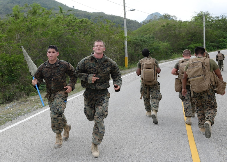 U.S. service members participate in the Sexual Assault Prevention and Response 5K Ruck March in Arroyo Cano, Dominican Republic, April 9, 2017. Statistically, most sexual assaults begin as sexual harassment and then escalate. (U.S. Air Force photo by Staff Sgt. Timothy M. Young)