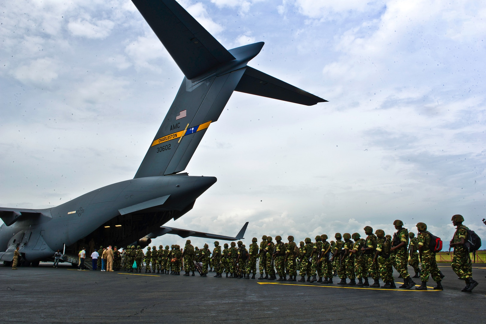 Burundi soldiers in 2013 prepare to load onto a C–17 at Bujumbura Airport in Burundi. In coordination with the French military and the African Union, the U.S. military provided airlift support to transport Burundi soldiers, food and supplies in the CAR