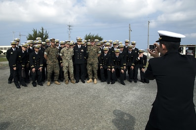 MCAS FUTENMA, OKINAWA, Japan – Marines and officer candidates pose for a group photo March 24 on Marine Corps Air Station Futenma, Okinawa, Japan. The candidates with the Japan Maritime Self-Defense Force received a brief on the cooperation between Marines and the Japan Self-Defense Force and the crucial role MCAS Futenma plays. (U.S. Marine Corps photo by Cpl. Jessica Collins)