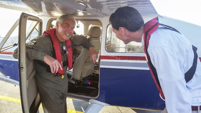 Civil Air Patrol mission pilot Capt. Richard Farmer, a member of the Florida Wing's Marco Island Senior Squadron, briefs WPTV reporter Charlie Keegan on safety procedures for a NORAD intercept exercise over south Florida. Photo by CAP Lt. Col. Jeff Carlson