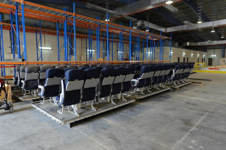 Seat kits, consisting of portable aircraft seats used inside transportation aircraft, are stored inside a Qatari facility recently constructed on Al Udeid Air Base, Qatar, on April 26, 2017. The new facility, used jointly by the U.S. and Qatari air forces, provides the proper environment, previously unavailable on Al Udeid Air Base, to store the kits.(U.S. Air Force photo by Tech. Sgt. Bradly A. Schneider)