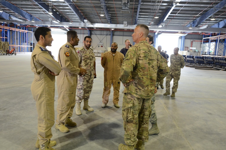 Qatari officials greet U.S. Air Force Lieutenant Colonel Robert Magee, squadron commander for the 8th Expeditionary Air Mobility Squadron (facing away from the camera), inside a newly constructed Qatari facility located at Al Udeid Air Base, Qatar, April 26, 2017. The Qatari officials and Macgee met inside the facility to observe a training exercise kicking off collaboration between the Qatari Air Force and the U.S. air force. (U.S. Air Force photo by Tech. Sgt. Bradly A. Schneider)