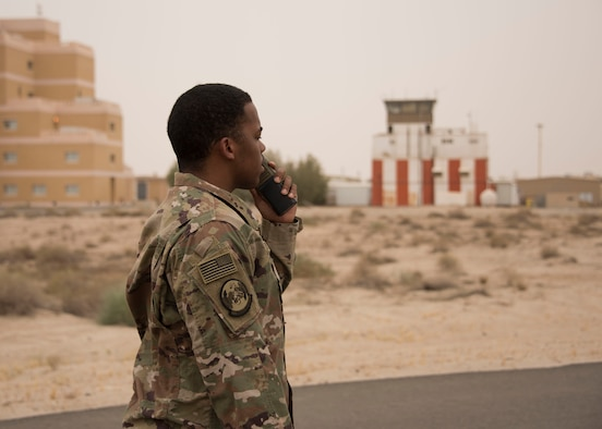 Senior Airman Jourdan Chaney, an airfield management specialist with the 386th Expeditionary Operations Support Squadron, communicates with air traffic controllers via radio at an undisclosed location in Southwest Asia, April 30, 2017. Airfield management specialists are the airfield operations eyes on the ground for the air traffic controllers in the tower. (U.S. Air Force photo/Tech. Sgt. Jonathan Hehnly)