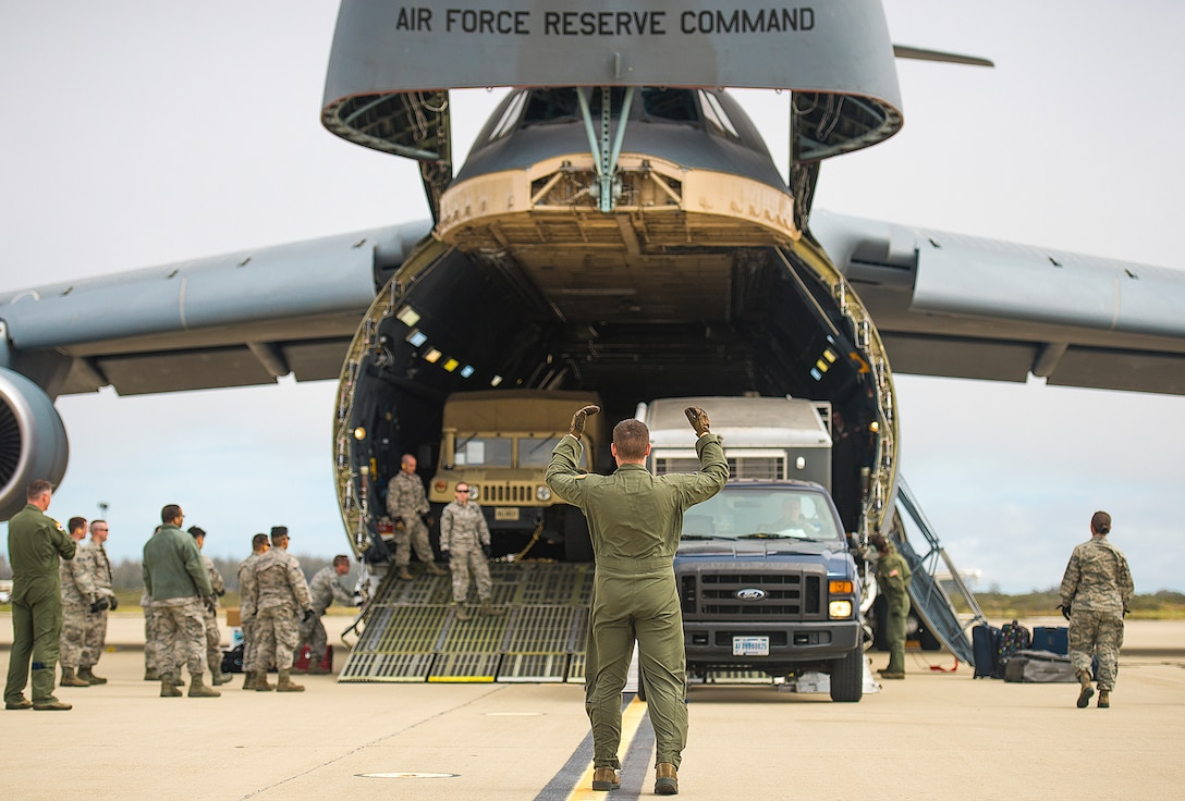 Airmen with the 68th Airlift Squadron unload vehicles from a C-5M Super Galaxy aircraft during exercise Patriot Hook April 26, 2017 at Vandenberg Air Force Base, California. Patriot Hook is an annual joint-service exercise coordinated by the Air Force Reserve, designed to integrate the military and first responders of federal, state and local agencies by providing training to mobilize quickly and deploying in military aircraft in the event of a regional emergency or natural disaster. (U.S. Air Force photo by Benjamin Faske)