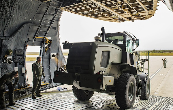 Airmen from the 433rd Airlift Wing unload a 10K all-terrain vehicle from a C-5M Super Galaxy aircraft during exercise Patriot Hook April 26, 2017 at Vandenberg Air Force Base, California. Patriot Hook is an annual joint-service exercise coordinated by the Air Force Reserve, designed to integrate the military and first responders of federal, state and local agencies by providing training to mobilize quickly and deploying in military aircraft in the event of a regional emergency or natural disaster. (U.S. Air Force photo by Benjamin Faske)