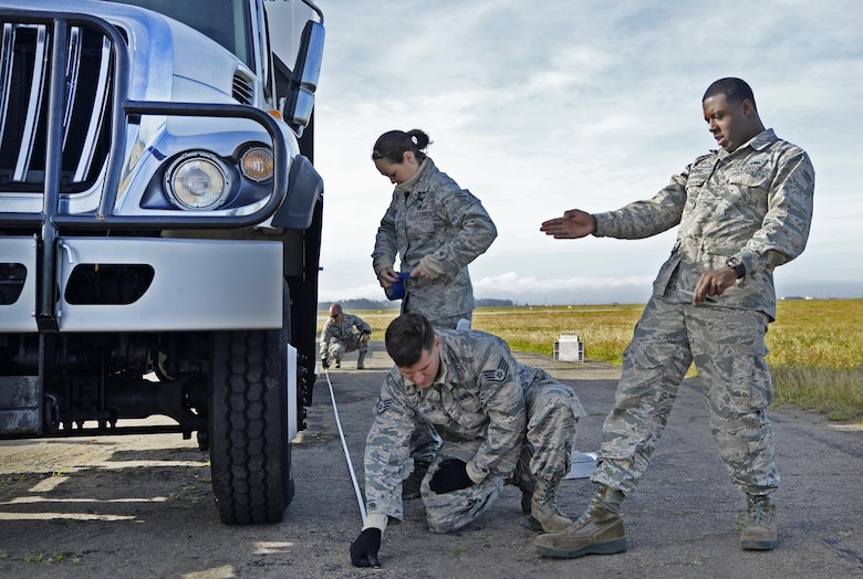 Staff Sgt. John Shue, Senior Airman Antonio Settle, and Senior Airman Audree Curry, 26th Aerial Port Squadron air transportation technicians, measure and weigh a vehicle before loading onto a C-5M Super Galaxy Aircraft during exercise Patriot Hook April 27, 2017 at Vandenberg Air Force Base.  Patriot Hook is an annual joint-service exercise coordinated by the Air Force Reserve, designed to integrate the military and first responders of federal, state and local agencies by providing training to mobilize quickly and deploying in military aircraft in the event of a regional emergency or natural disaster.  (U.S. Air Force photo by Benjamin Faske